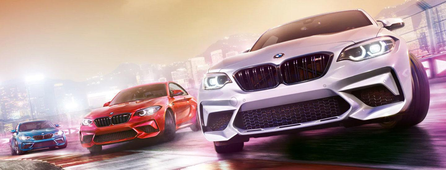 Three 2020 BMW 2 Series vehicles driving next to each other