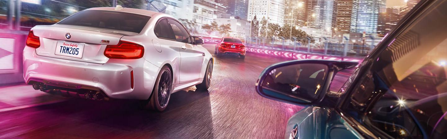 2020 BMW 2 Series models turning on a road