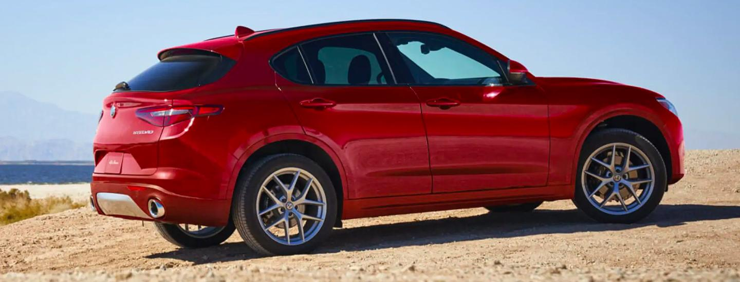 A red 2021 Stelvio parked on the beach