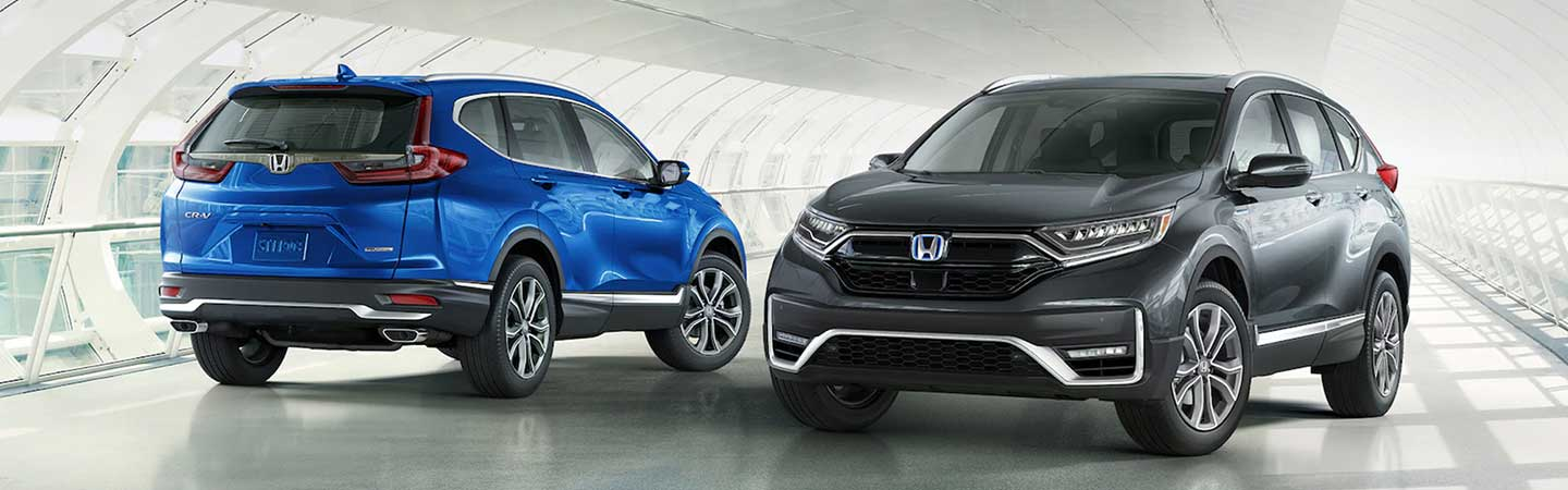 Blue Metallic and a Steel Metallic 2021 CR-V parked next to each other