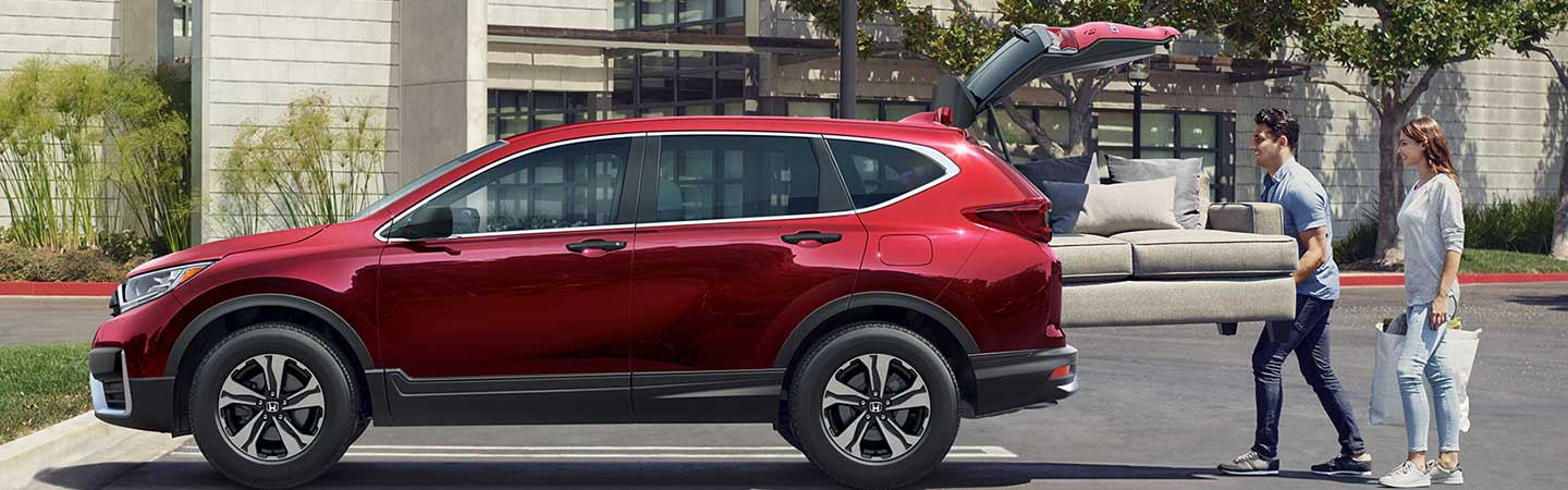 Couch being loaded into Red Metallic 2021 Honda CR-V