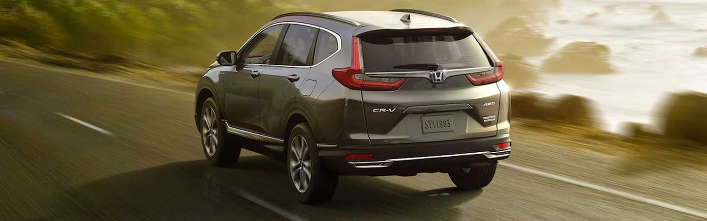 2021 CR-V driving away by the ocean