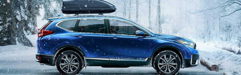 2021 Aegean Blue Metallic CR-V Honda parked in the snow