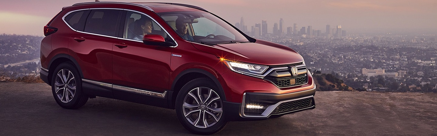 Side view of a Radiant Red Metallic 2021 Honda CR-V