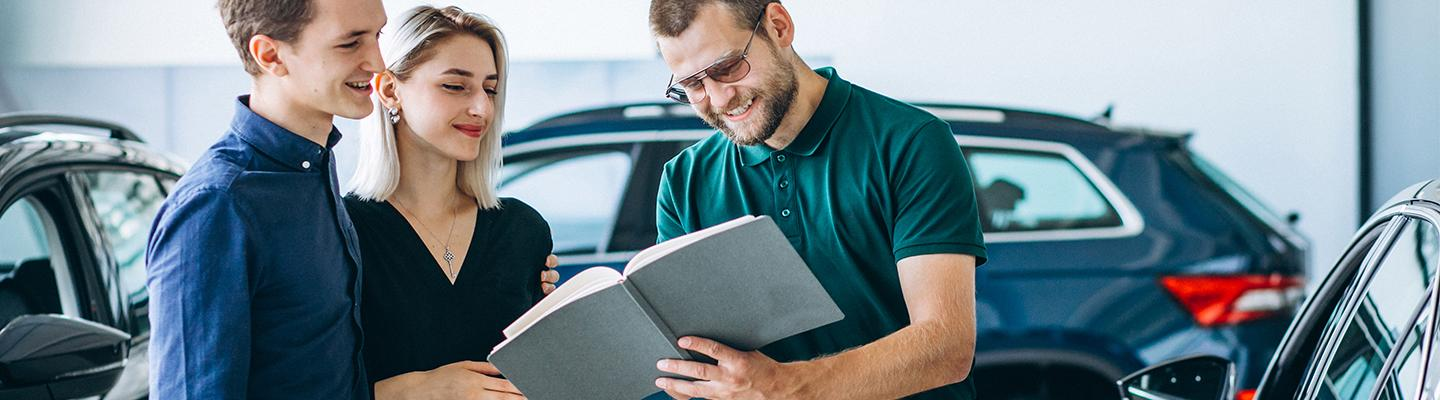 A finance professional reviewing paperwork with customers