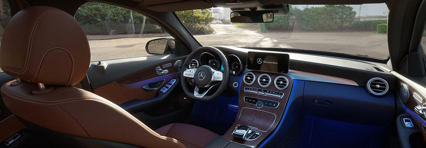 Interior infotainment and steering wheel view of the 2020 C-Class.