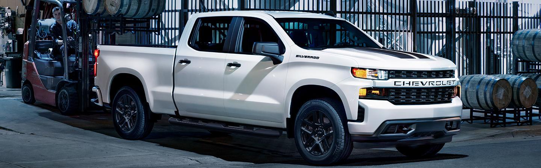 White 2021 Chevrolet Silverado loading barrels