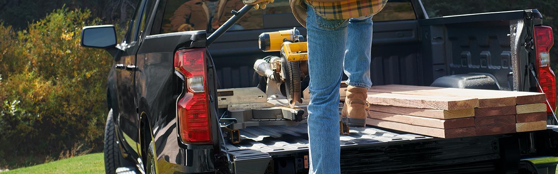 2021 Chevrolet Silverado on work site man unloading