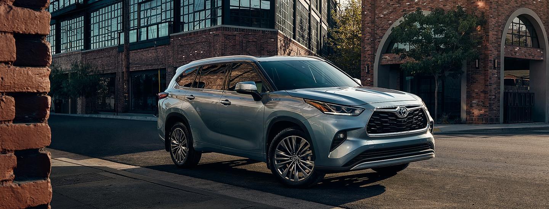 2020 Toyota Highlander driving through a city