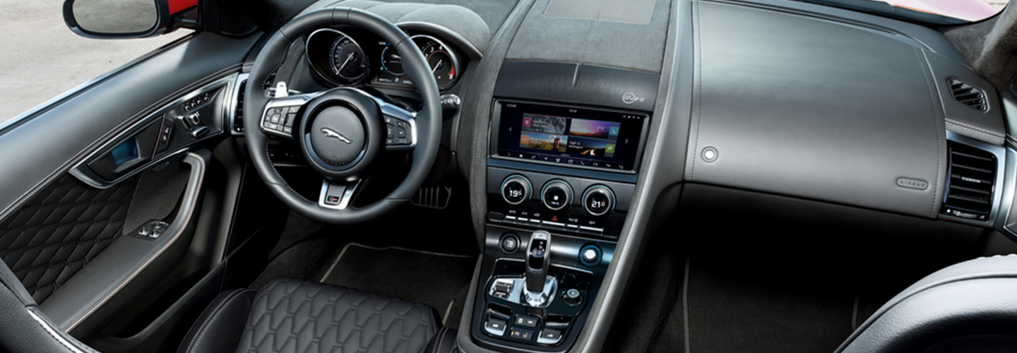 2020 Jaguar F-Type interior, highlighting the steering wheel and entertainment console, in Ocala, FL