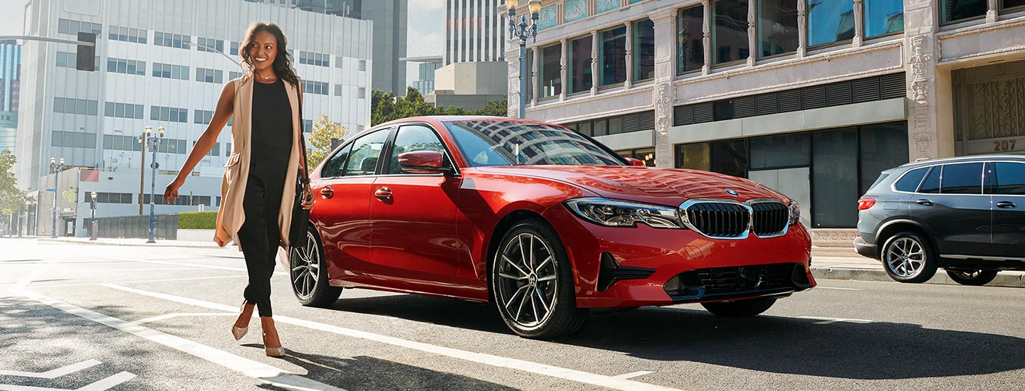 2020 BMW 3 Series driving on a city street