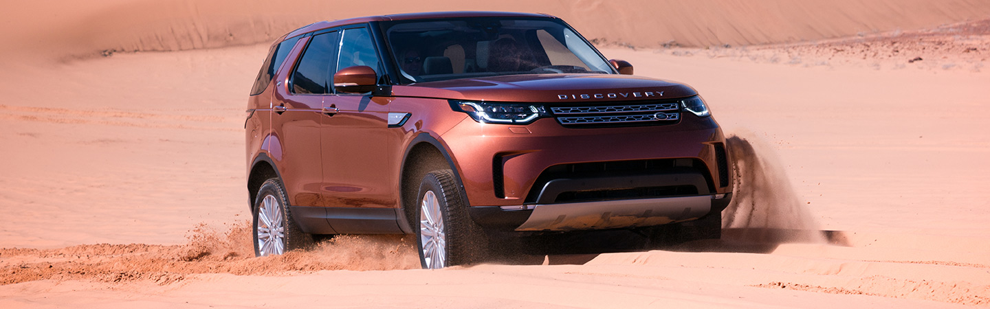 2019 Land Rover Discovery driving through the desert, available at Land Rover Ocala