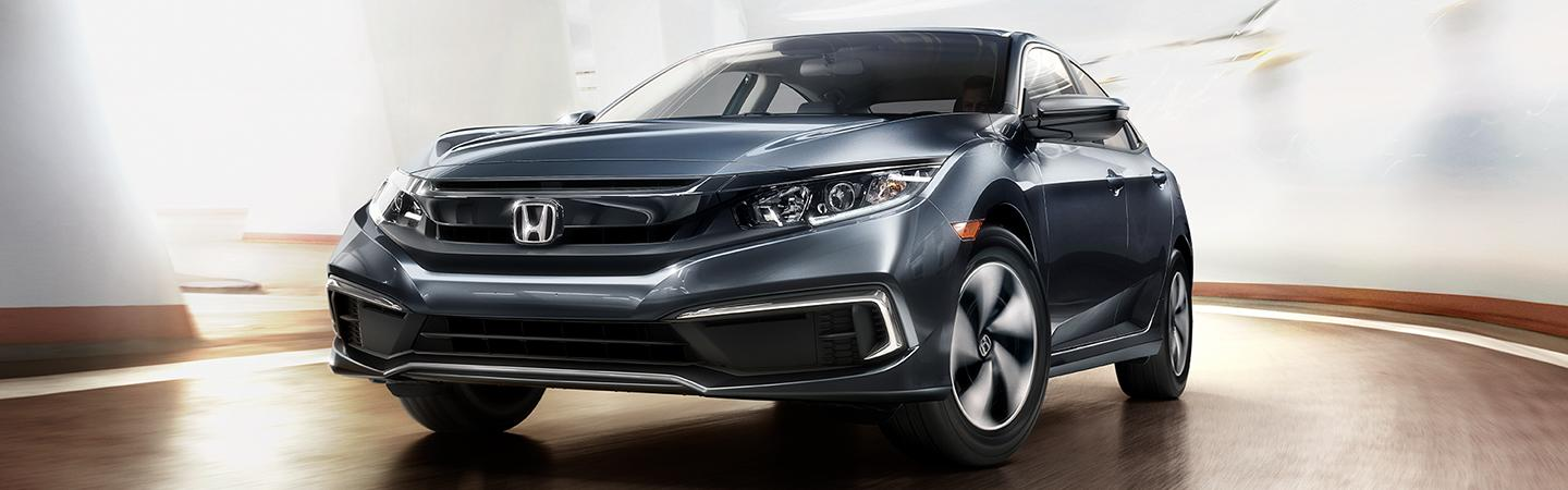 Front view of the 2020 Honda Civic in motion outside