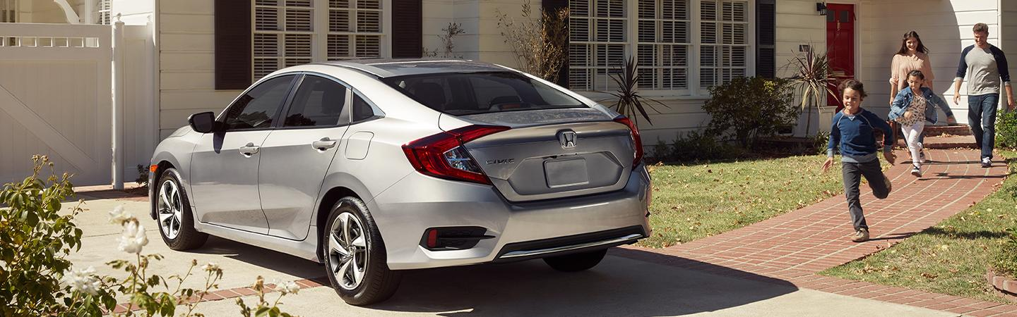 Rear view of the 2020 Honda Civic outside of a house