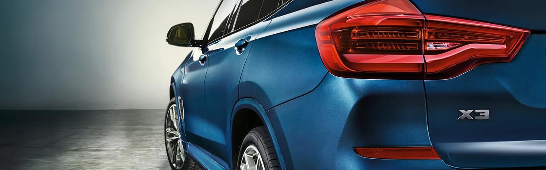 Rear view of blue 2021 BMW X3