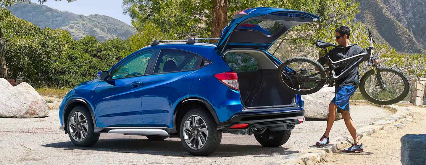 2019 Honda HR-V parked being loaded with mountain bike.
