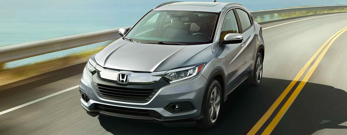 2019 Honda HR-V front view in motion on scenic coastal road.