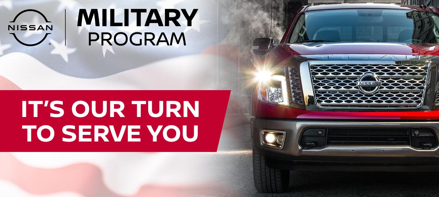 It's Our Turn To Serve You Military Program with Red Nissan view front grill