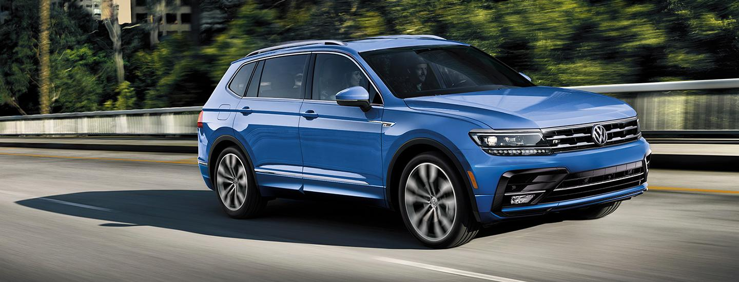 Side view of the 2020 Volkswagen Tiguan in motion outside of Gainesville, FL