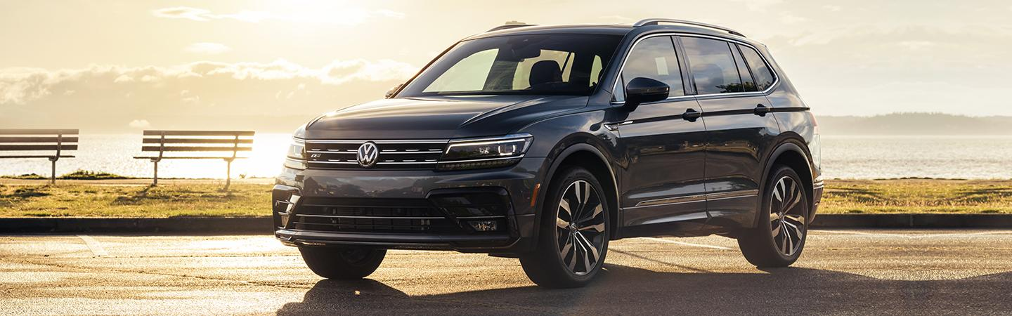 Front view of the 2020 Volkswagen Tiguan parked in a sunset