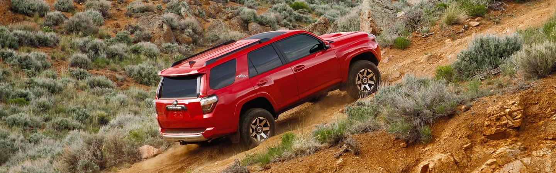 Red 2020 Toyota 4Runner driving uphill