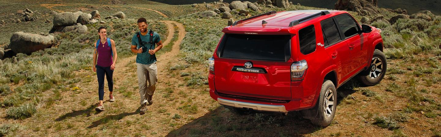 Red 2020 Toyota 4Runner parked with people walking in the background