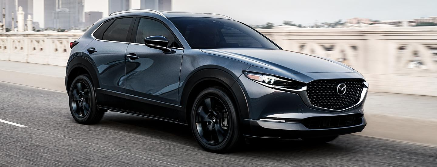 Passenger front view of the 2021 Mazda CX-5 in motion
