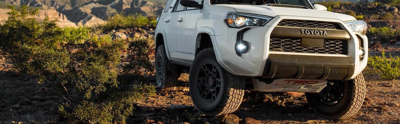 White 2020 Toyota 4Runner parked on rocks