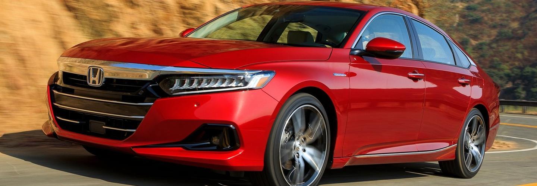 Red Honda driving to Spitzer Honda