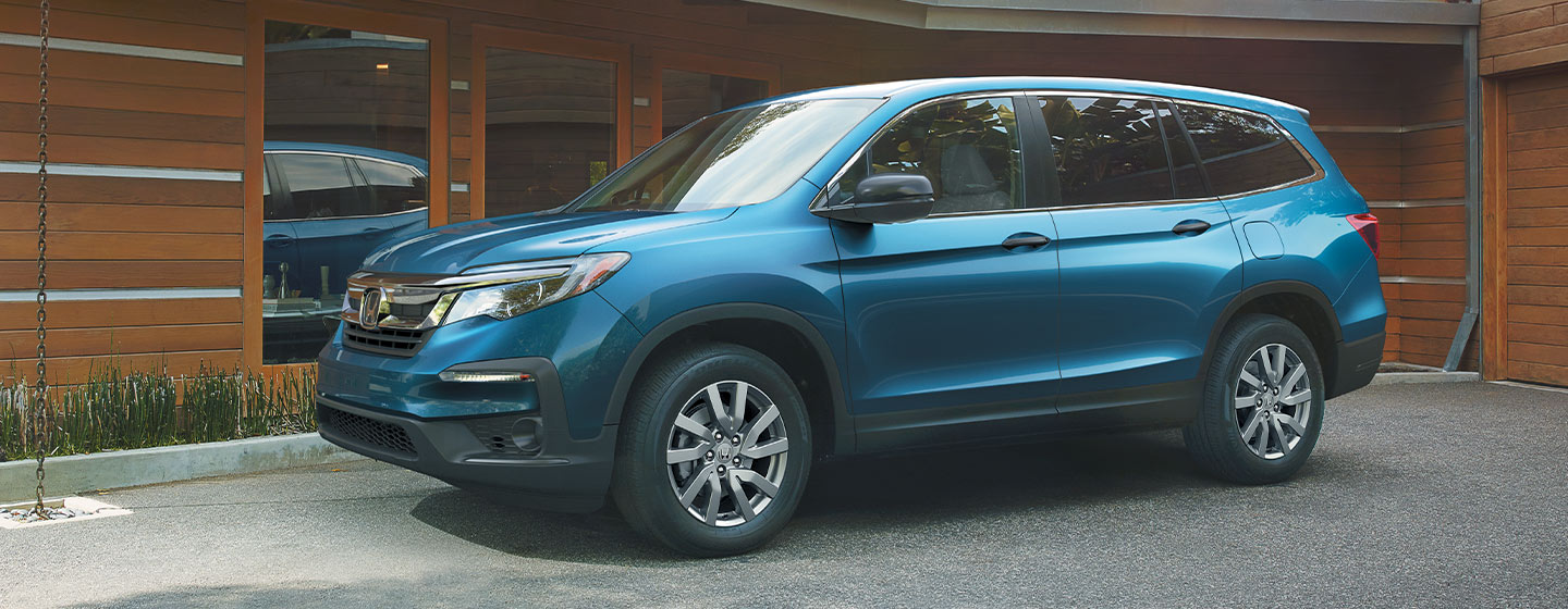 2019 Honda Pilot Exterior - Side View - Parked outside of a house.