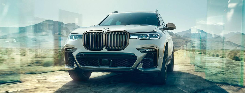 White 2021 BMW X7 Driving Through Mountains