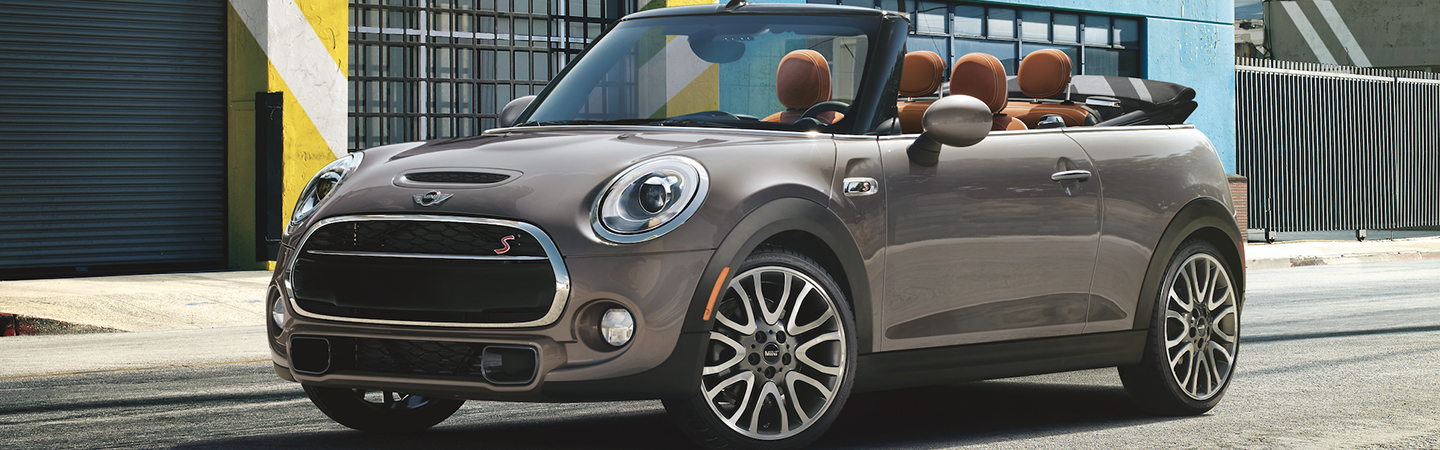 Angled profile of a parked silver MINI Cooper Convertible