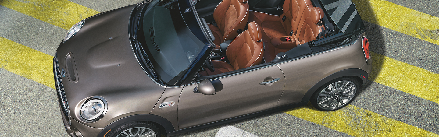Overhead view of a parked silver MINI Cooper Convertible