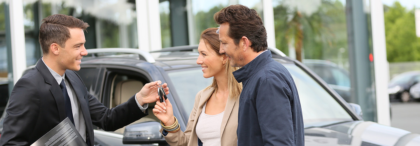 Picture of a couple buying a car at Marlow Ford dealership near Stanley Virginia.