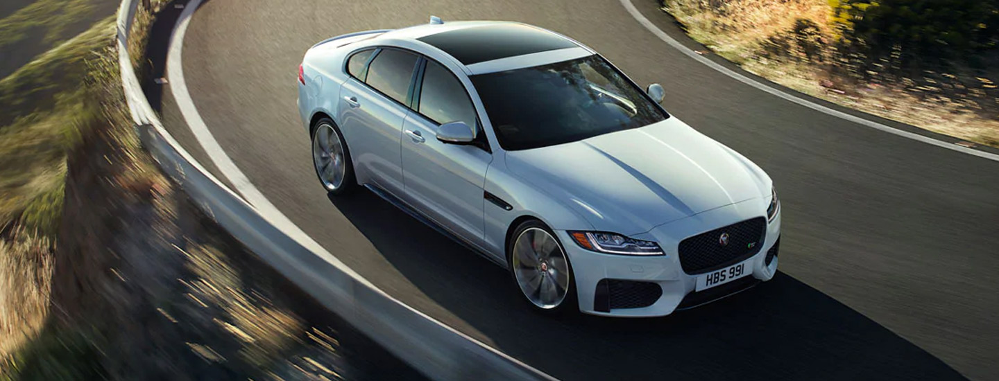 Overview of the 2020 jaguar XF in motion outside of Jaguar Ocala