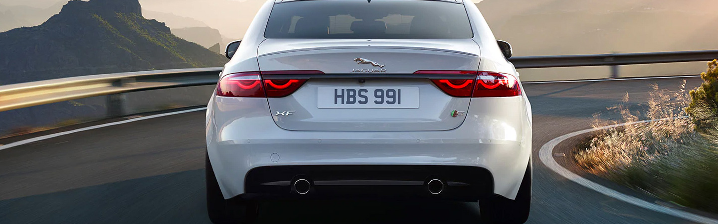 Rear view of the 2020 Jaguar XF driving