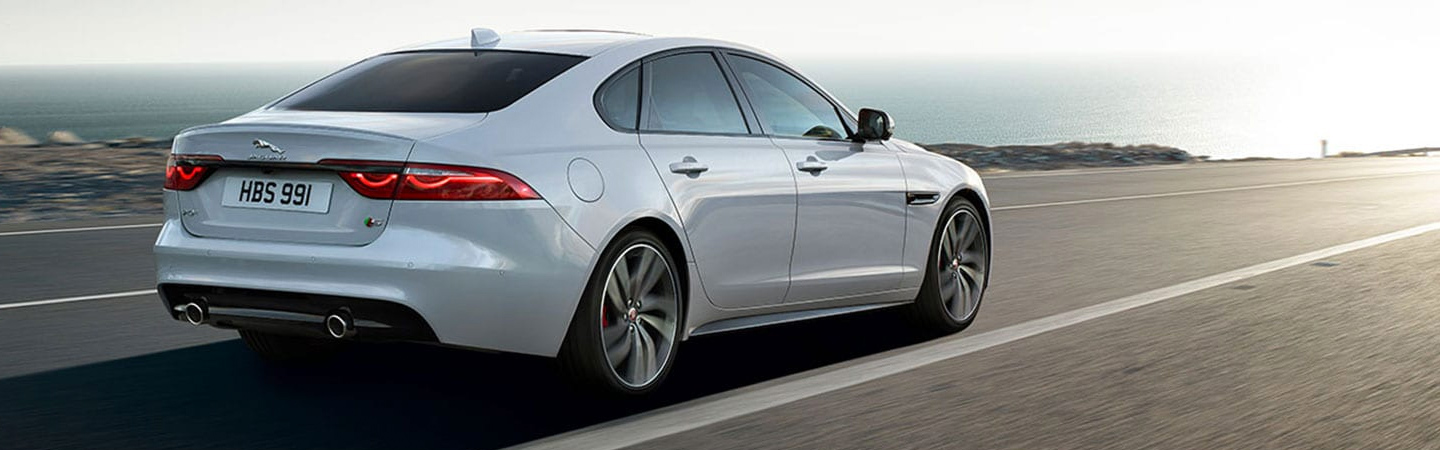 Side profile of the 2020 Jaguar XF in motion