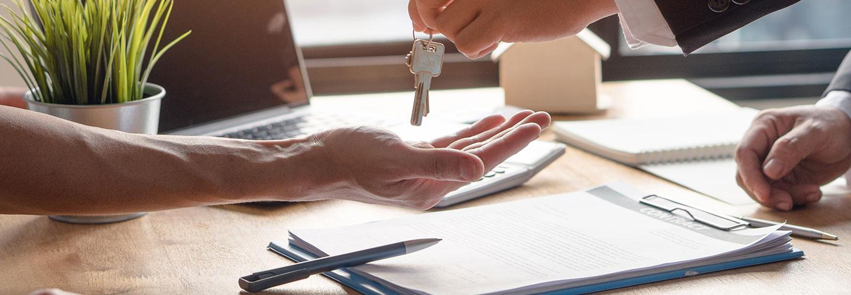 Salesman handing over brand new vehicle keys