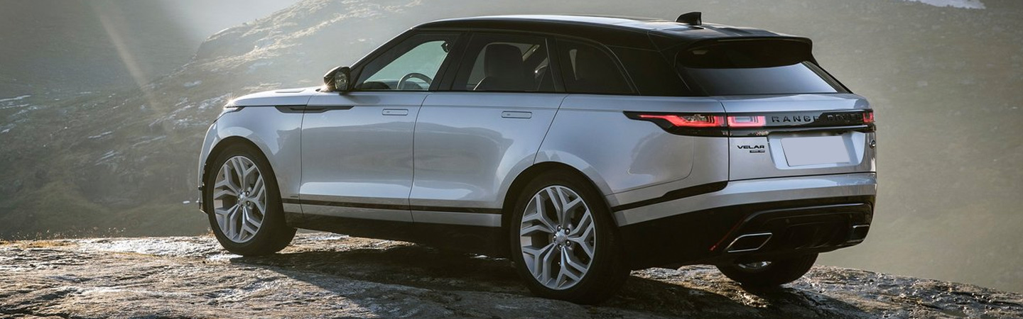 Side-rear profile of the 2020 Range Rover Velar on a hill