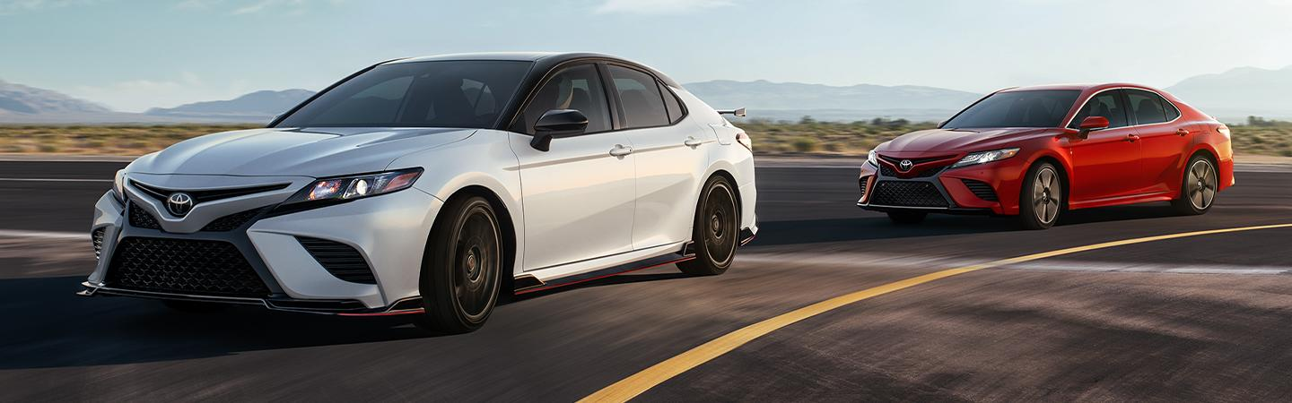 Two 2020 Toyota Camry vehicles in motion