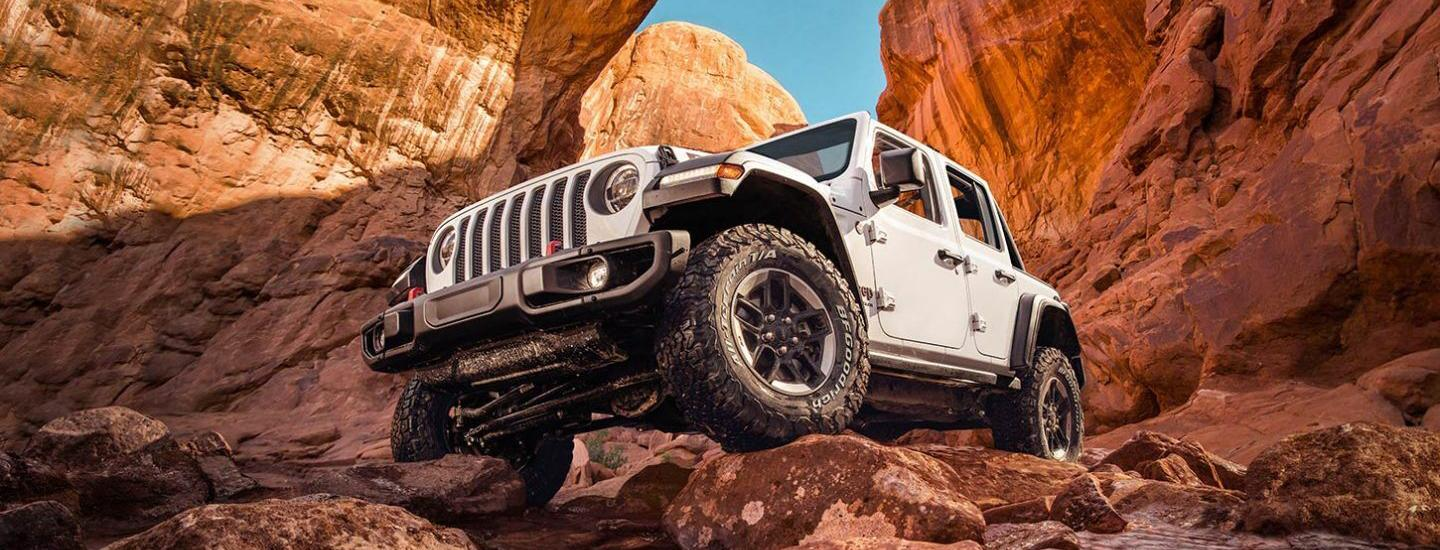 View of underneath a 2020 Jeep Wrangler off roading through a canyon
