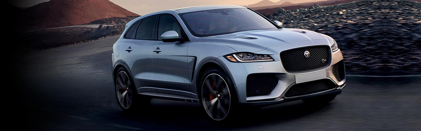 Front view of the 2020 Jaguar F-pace driving up hill