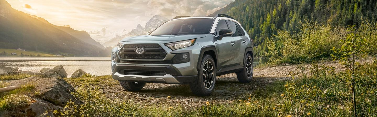 2020 Toyota RAV4 parked in a field of grass