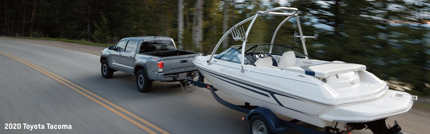 2020 Toyota Tacoma towing a boat