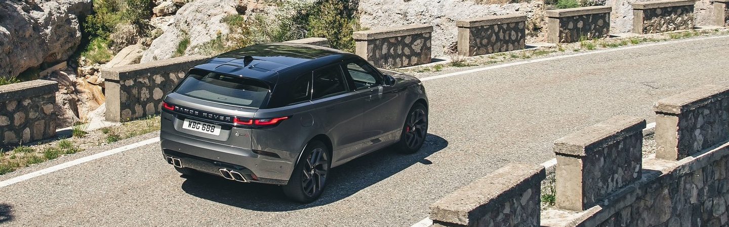 Rear view of the 2020 Land Rover Range Rover in motion outside