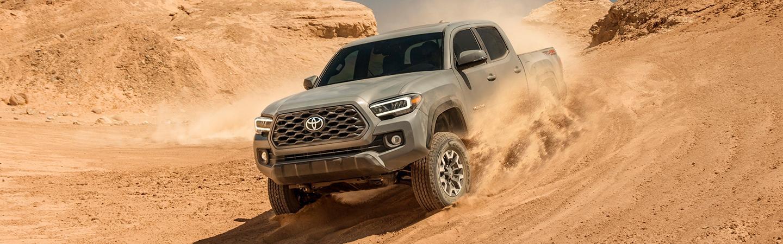 2020 Toyota Tacoma driving through dirt