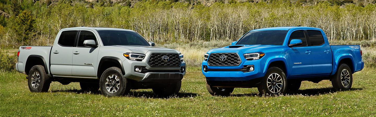 Two 2020 Toyota Tacoma vehicles parked in the grass