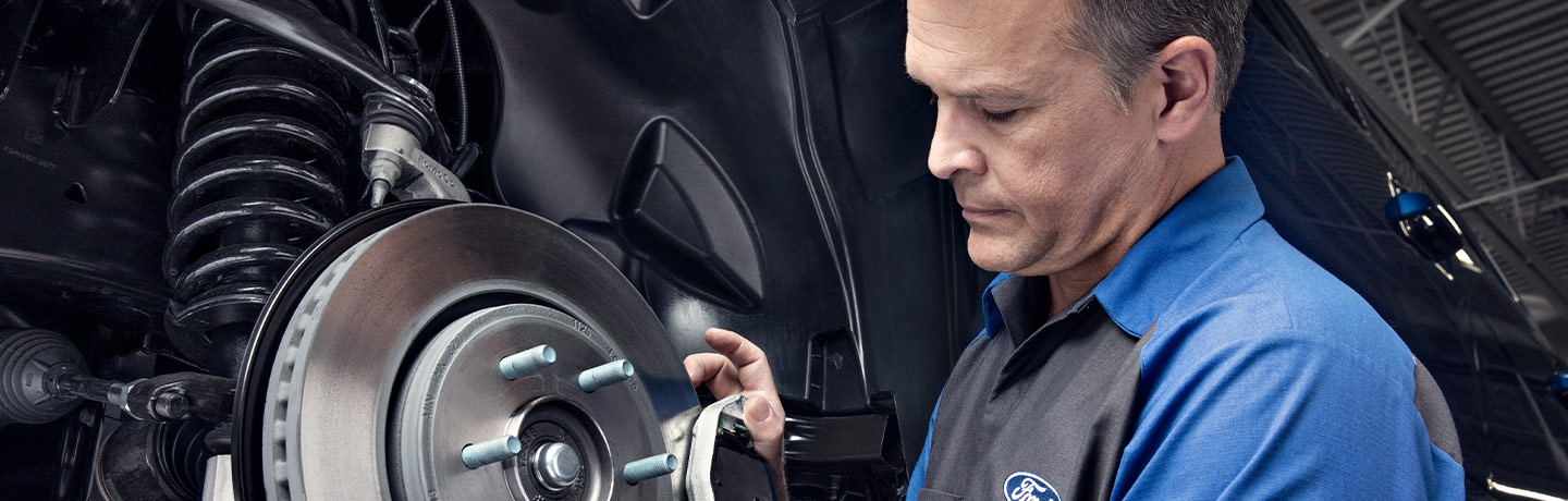 Ford Technician working on brakes