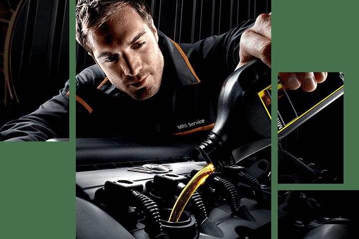 Mechanic shining a MINI vehicle