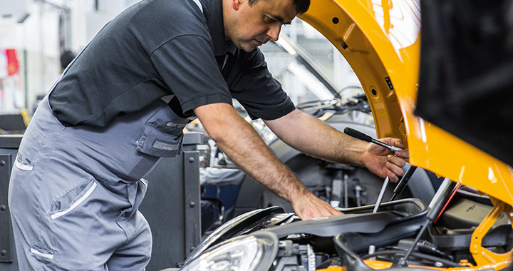 Mechanic working under the hood of a MINI vehicle